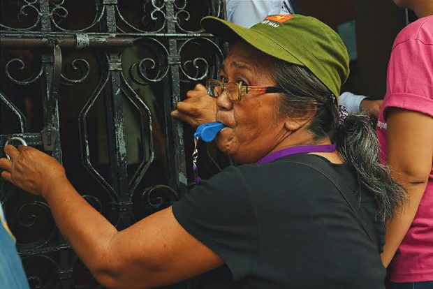 A GWP member participates in a noise barrage at the Comelec Central office to demand for the immediate resolution for their motion for the proclamation of Indayla as their third representative to the 17th Congress. (Photo by Keilah Dimpas)