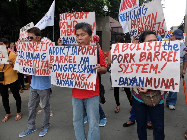 Activists say that lawmakers' insistence on dictating the flow of DSWD services is a continuation of the unlawful 'pork barrel' system. (Photo by Raymund B. Villanueva)